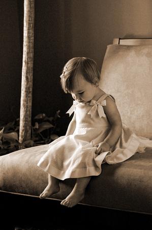 portrait of little girl on bench